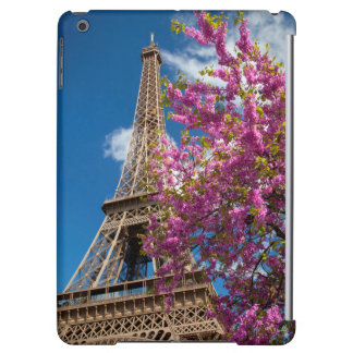 Pink Blossoming Tree Below The Eiffel Tower