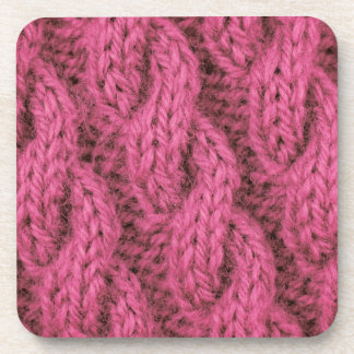 Pink cable knitting drink coasters