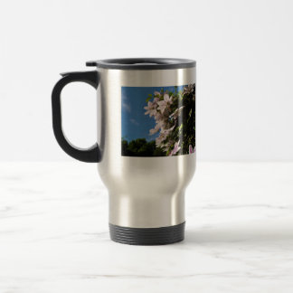 Pink clematis blossoming on a sunny day mug