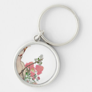 Pink cockatoo, on mantle of flowers keychain