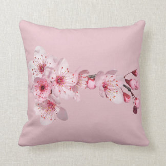Pink cushion clearly with flower of natural cherry