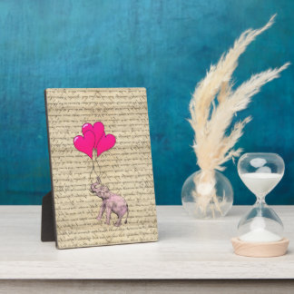 Pink elephant holding balloons plaque