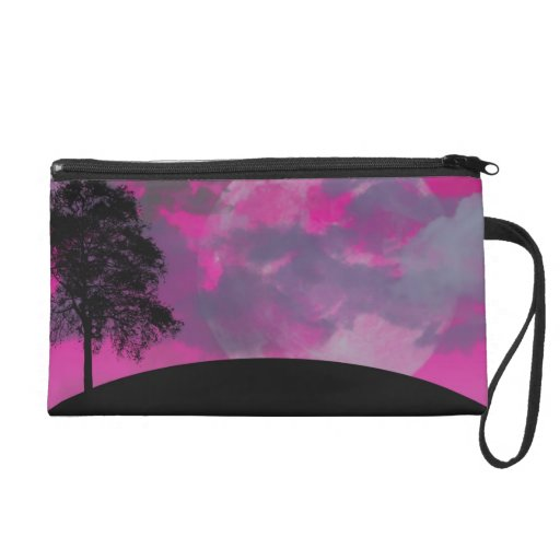 Pink fantasy moon, clouds & black tree silhouette wristlet clutches