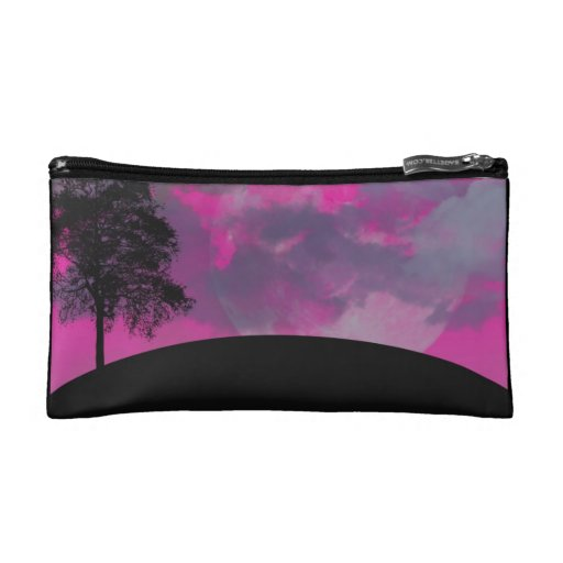 Pink fantasy moon, clouds & black tree silhouette cosmetic bag