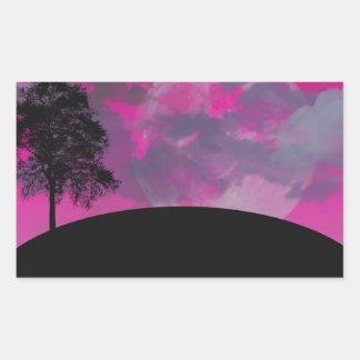 Pink fantasy moon, clouds & black tree silhouette rectangular sticker