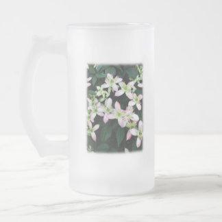 Pink flowers. Clematis. On White. Mug