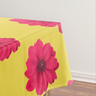 pink flowers on yellow tablecloth