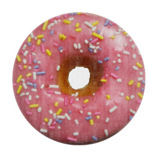 Pink glazed donut with sprinkles cutting boards