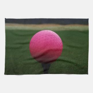 Pink Golf Ball on a mountain golf course Tea Towel