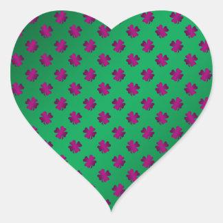 Pink shamrocks on green background heart sticker