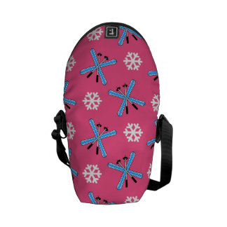 Pink skis and snowflakes pattern courier bag