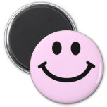 Pink smiley face refrigerator magnets
