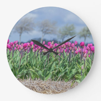 Pink tulips in the wind wall clock