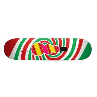 Pink yellow snowman on red green swirl skate board deck