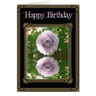 Pinkish rose reflection on black greeting card