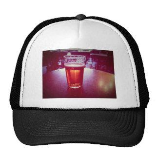 Pint of British ale beer in a pub Cap