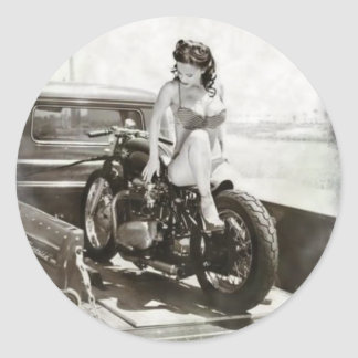 PINUP GIRL ON MOTORCYCLE. ROUND STICKER