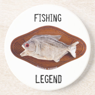 Piranha fish as trophy on wood coaster