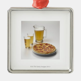 Pitcher and two pints of beer beside pepperoni christmas ornament
