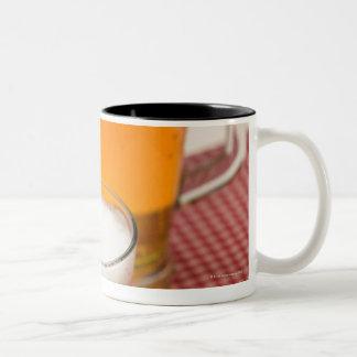 Pitcher of beer and two glasses filled with beer Two-Tone coffee mug