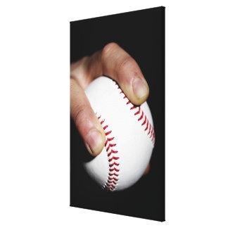 Pitchers hand gripping a baseball canvas print
