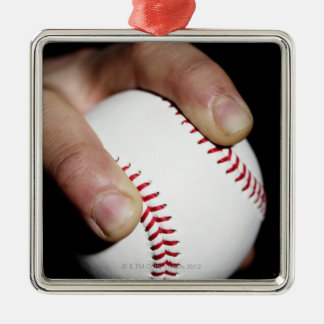 Pitchers hand gripping a baseball christmas ornament