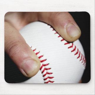 Pitchers hand gripping a baseball mouse mat