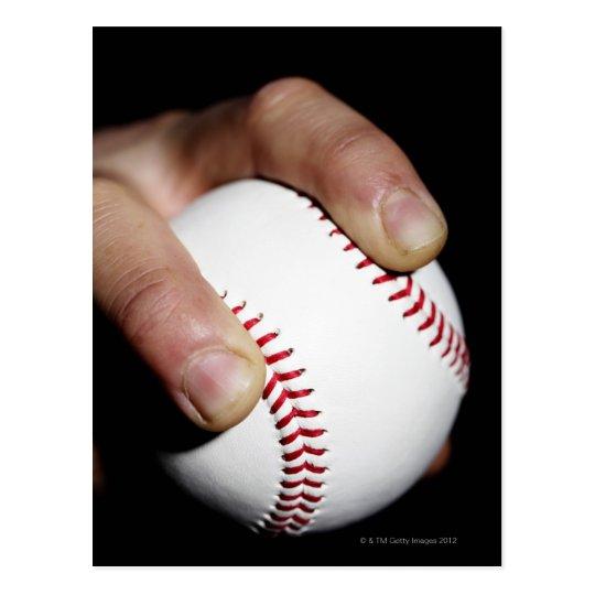 Pitchers hand gripping a baseball postcard