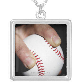 Pitchers hand gripping a baseball silver plated necklace