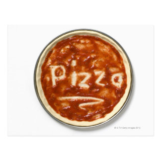 Pizza base with tomato sauce and the word postcard