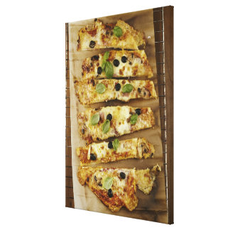 Pizza cut into pieces canvas print