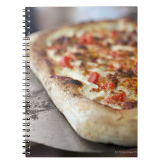 Pizza with tomatoes, garlic and meat substitute notebook