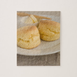 Plain scone with butter on plate jigsaw puzzle