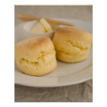 Plain scone with butter on plate poster