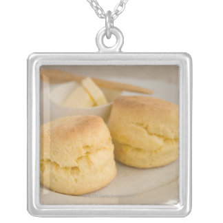 Plain scone with butter on plate silver plated necklace