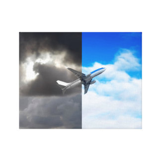 Plane flying out of stormy sky into blue sky canvas print
