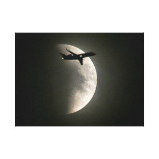 Plane over the Moon Canvas Print