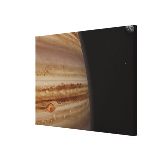 Planet Jupiter and a Distant Moon Stretched Canvas Print