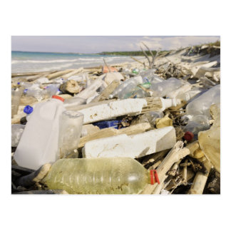 Plastic bottles and ocean dumping on a tropical postcard