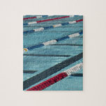 Plastic separators in a swimming pool creating jigsaw puzzle