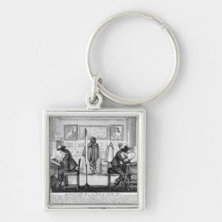 Plate engravers working with gallery key chains
