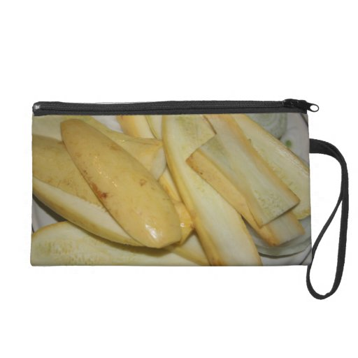 Plate of sliced yellow summer squash food wristlet