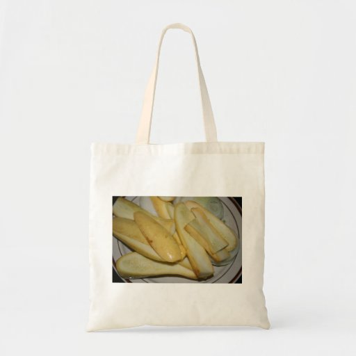Plate of sliced yellow summer squash food tote bag