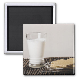 Plate of snacks with a glass of milk magnet