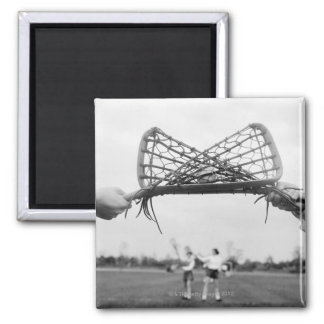 Play starts in a lacrosse team with the draw.Two Square Magnet