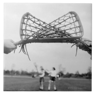 Play starts in a lacrosse team with the draw.Two Tile
