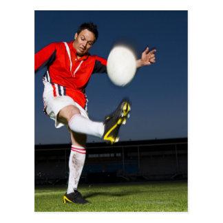 Player kicking ball postcard