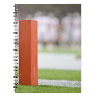 Players in background. notebook