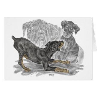Playful Doberman Pinscher Puppies Card
