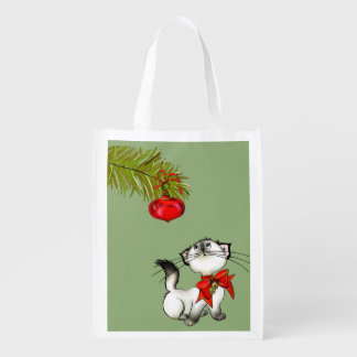 Playful Kitty Cat In A Red Christmas Bow